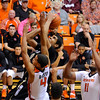 Colorado's Josh Scott (40) shoots against Oregon State's Challe Barton (4) and Joe Burton (11) during the first half of an NCAA college basketball game in Corvallis, Ore., Sunday, Feb. 10, 2013. (AP Photo/Greg Wahl-Stephens)