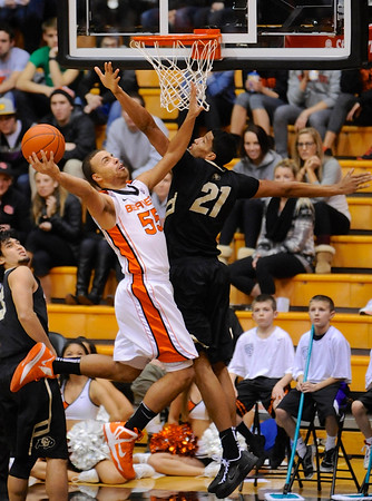 Colorado's Andre Robeson (21) defends a shot by Oregon State's Roberto Nelson (55) during the first half of an NCAA college basketball game in Corvallis, Ore., Sunday, Feb. 10, 2013. (AP Photo/Greg Wahl-Stephens)