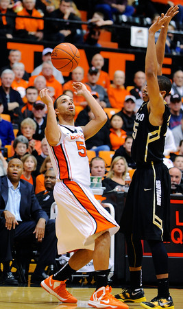 Oregon State's Roberto Nelson (55) juggles the ball against Colorado's Spencer Dinwiddie (25) during the second half of an NCAA college basketball game in Corvallis, Ore., Sunday, Feb. 10, 2013. Colorado won 72-68. (AP Photo/Greg Wahl-Stephens)