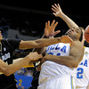 Colorado forward Andre Roberson, left, reaches for a loose ball along with UCLA center Joshua Smith during the second half of their NCAA college basketball game on Saturday, Jan. 28, 2012, in Los Angeles. UCLA won 77-60. (AP Photo/Mark J. Terrill)