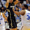 Colorado guard Askia Booker, left, passes the ball as UCLA center Joshua Smith defends during the second half of their NCAA college basketball game on Saturday, Jan. 28, 2012, in Los Angeles. UCLA won 77-60. (AP Photo/Mark J. Terrill)