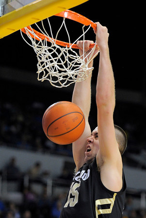Colorado center Shane Harris-Tunks dunks during the first half of their NCAA college basketball game against the UCLA, Saturday, Jan. 28, 2012, in Los Angeles. (AP Photo/Mark J. Terrill)