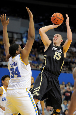 Colorado center Shane Harris-Tunks, right, puts up a shot as UCLA center Joshua Smith defends during the first half of their NCAA college basketball game on Saturday, Jan. 28, 2012, in Los Angeles. (AP Photo/Mark J. Terrill)