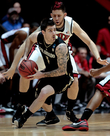 Colorado senior Nate Tomlinson looks to pass while being defended during CU's 68-64 victory over UNLV on Thursday. (AP Photo/Jake Schoellkopf)