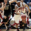 UNLV guard Oscar Bellfield (0) brings the ball up against Colorado during the first half of an NCAA men's college basketball tournament second-round game Thursday, March 15, 2012, in Albuquerque, N.M. (AP Photo/Jake Schoellkopf)