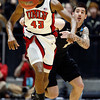 UNLV forward Mike Moser (43) and Colorado guard Nate Tomlinson, right, chase down the ball during the first half of an NCAA men's college basketball tournament second-round game Thursday, March 15, 2012, in Albuquerque, N.M. (AP Photo/Matt York)