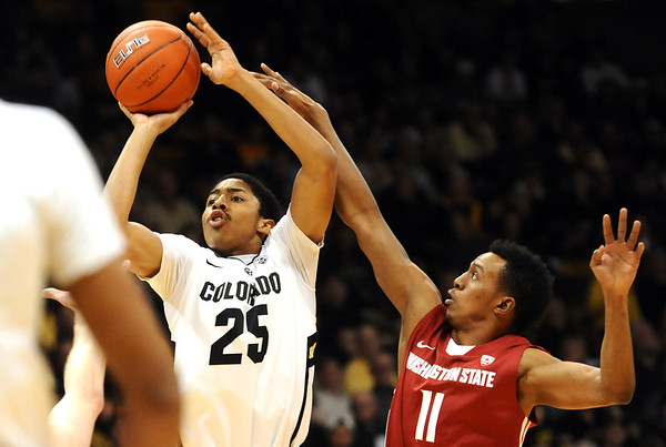 University of Colorado's #25 Spencer Dinwiddie shoots over Washington State's #11 Faisal Aden during their game at the Coors Events Center on the University of Colorado Boulder, Colo. Campus on Saturday January 7, 2012<br /> Photo by Paul Aiken  Jan 7, 2012