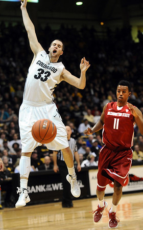 University of Colorado's #33 Austin Dufault looks for a shooting foul as Washington State's #11Faisal Aden tracks the ball during their game at the Coors Events Center on the University of Colorado Boulder, Colo. Campus on Saturday January 7, 2012<br /> Photo by Paul Aiken  Jan 7, 2012