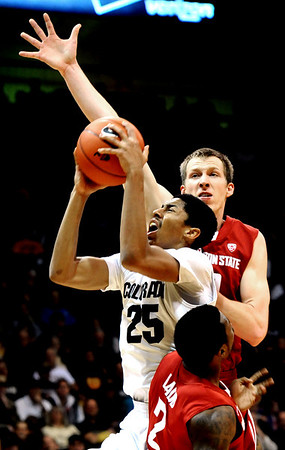 University of Colorado's #25 Spencer Dinwiddie shoots over Washington State's #2 Mike Ladd while #40 Charlie Enquist attempts a block during their game at the Coors Events Center on the University of Colorado Boulder, Colo. Campus on Saturday January 7, 2012<br /> Photo by Paul Aiken  Jan 7, 2012