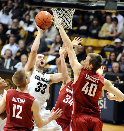 University of Colorado's #33 Austin Dufault fights to the hoop against  Washington State's #12 Brock Motum, #40 Charlie Enquist and #34 Dexter Kernich-Drew during their game at the Coors Events Center on the University of Colorado Boulder, Colo. Campus on Saturday January 7, 2012<br /> Photo by Paul Aiken  Jan 7, 2012