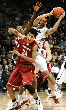 University of Colorado's #23 Sabatino Chen pulls down a rebound over Washington State's #34 Dexter Kernich-Drew and #0 Marcus Capers during their game at the Coors Events Center on the University of Colorado Boulder, Colo. Campus on Saturday January 7, 2012<br /> Photo by Paul Aiken  Jan 7, 2012