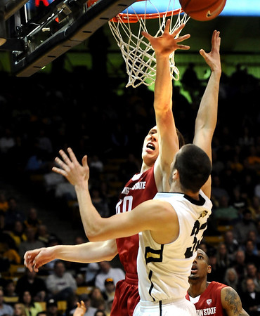 University of Colorado's #33 Austin Dufault shoots against  Washington State's #40 Charlie Enquist at the Coors Events Center on the University of Colorado Boulder, Colo. Campus on Saturday January 7, 2012<br /> Photo by Paul Aiken  Jan 7, 2012