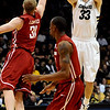 University of Colorado's #33 Austin Dufault shoots over Washington State's #31 Abe Lodwick during their game at the Coors Events Center on the University of Colorado Boulder, Colo. Campus on Saturday January 7, 2012<br /> Photo by Paul Aiken  Jan 7, 2012