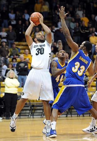 """Carlon Brown of Colorado, drives past Rashad Savage of Cal-State Bakersfield during the first half of the December 19, 2011 game in Boulder.<br /> during the first half of the December 19, 2011 game in Boulder.<br /> <br /> For more photos of the game, go to  <a href=""""http://www.dailycamera.com"""">http://www.dailycamera.com</a>.<br /> December 19, 2011 / Cliff Grassmick"""