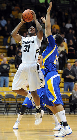 "Jeremy Adams of CU shoots over Adam Young of Cal-State Bakersfield during the first half of the December 19, 2011 game in Boulder.<br /> <br /> For more photos of the game, go to  <a href=""http://www.dailycamera.com"">http://www.dailycamera.com</a>.<br /> December 19, 2011 / Cliff Grassmick"