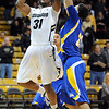 """Jeremy Adams of CU shoots over Adam Young of Cal-State Bakersfield during the first half of the December 19, 2011 game in Boulder.<br /> <br /> For more photos of the game, go to  <a href=""""http://www.dailycamera.com"""">http://www.dailycamera.com</a>.<br /> December 19, 2011 / Cliff Grassmick"""