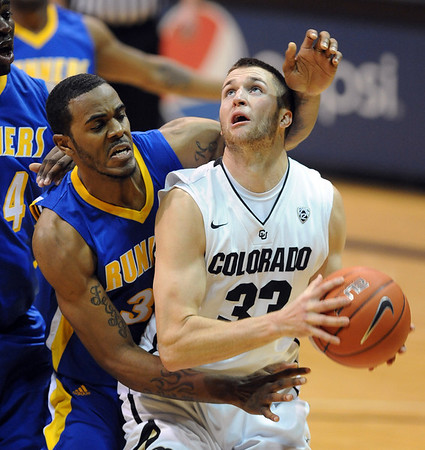 """Austin Dufault of Colorado prepares to shoot over Rashad Savage of Cal-State Bakersfield during the second half of the December 19, 2011 game in Boulder.<br /> <br /> For more photos of the game, go to  <a href=""""http://www.dailycamera.com"""">http://www.dailycamera.com</a>.<br /> December 19, 2011 / Cliff Grassmick"""