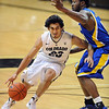 "Sabatino Chen of Colorado drives around Mo Hughley of CSU-bakersfield during the second half of the December 19, 2011 game in Boulder.<br /> <br /> For more photos of the game, go to  <a href=""http://www.dailycamera.com"">http://www.dailycamera.com</a>.<br /> December 19, 2011 / Cliff Grassmick"