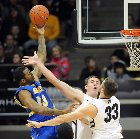 """Rashad Savage of Cal-State Bakersfield gets a shot over Shane Harris-Tunks and Austin Dufault (33) of Colorado<br /> during the first half of the December 19, 2011 game in Boulder.<br /> <br /> For more photos of the game, go to  <a href=""""http://www.dailycamera.com"""">http://www.dailycamera.com</a>.<br /> December 19, 2011 / Cliff Grassmick"""