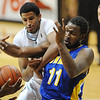 "Andre Roberson of CU  and Mo Hughley of CSU-Bakersfield fight for a rebound during the second half of the December 19, 2011 game in Boulder.<br /> <br /> For more photos of the game, go to  <a href=""http://www.dailycamera.com"">http://www.dailycamera.com</a>.<br /> December 19, 2011 / Cliff Grassmick"