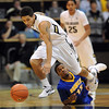 "Askia Booker of Colorado, takes off with a steal as Issiah Grayson of California State- Bakersfield looks on during the first half of the December 19, 2011 game in Boulder.<br /> <br /> For more photos of the game, go to  <a href=""http://www.dailycamera.com"">http://www.dailycamera.com</a>.<br /> December 19, 2011 / Cliff Grassmick"