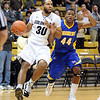 "Carlon Brown of Colorado, drives past Stephon Carter of Cal-State Bakersfield during the first half of the December 19, 2011 game in Boulder.<br /> <br /> For more photos of the game, go to  <a href=""http://www.dailycamera.com"">http://www.dailycamera.com</a>.<br /> December 19, 2011 / Cliff Grassmick"