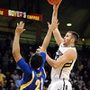 """Austin Dufault of Colorado shoots over Adam Young of Cal- State Bakersfield during the first half of the December 19, 2011 game in Boulder.<br /> <br /> For more photos of the game, go to  <a href=""""http://www.dailycamera.com"""">http://www.dailycamera.com</a>.<br /> December 19, 2011 / Cliff Grassmick"""