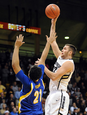 "Austin Dufault of Colorado shoots over Adam Young of Cal- State Bakersfield during the first half of the December 19, 2011 game in Boulder.<br /> <br /> For more photos of the game, go to  <a href=""http://www.dailycamera.com"">http://www.dailycamera.com</a>.<br /> December 19, 2011 / Cliff Grassmick"