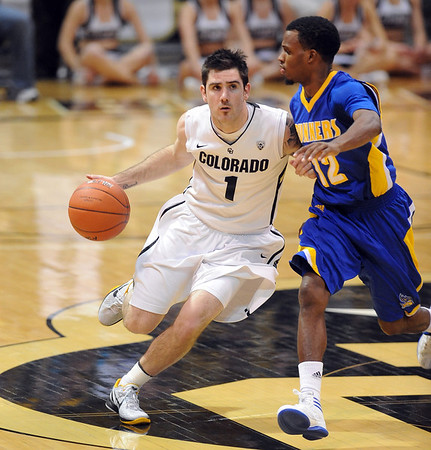 """Nate Tomlinson of Colorado drives into Issaiah Grayson of Cal-State Bakersfield during the second half of the December 19, 2011 game in Boulder.<br /> <br /> For more photos of the game, go to  <a href=""""http://www.dailycamera.com"""">http://www.dailycamera.com</a>.<br /> December 19, 2011 / Cliff Grassmick"""