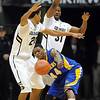 """Stephon Carter of California State- Bakersfield, gets the ball out from the pressure of Andre Roberson and Jeremy Adams, of Colorado during the first half of the December 19, 2011 game in Boulder.<br /> <br /> For more photos of the game, go to  <a href=""""http://www.dailycamera.com"""">http://www.dailycamera.com</a>.<br /> December 19, 2011 / Cliff Grassmick"""
