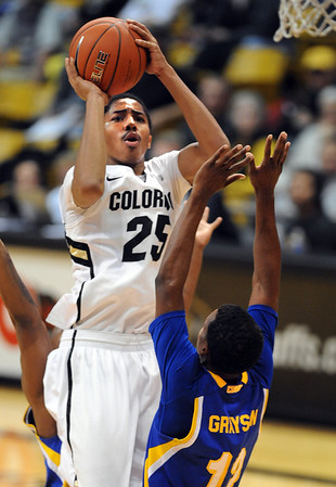 "Spencer Dinwiddie of Colorado shoots over Issiah Grayson of Cal State Bakersfield during the second half of the December 19, 2011 game in Boulder.<br /> <br /> For more photos of the game, go to  <a href=""http://www.dailycamera.com"">http://www.dailycamera.com</a>.<br /> December 19, 2011 / Cliff Grassmick"