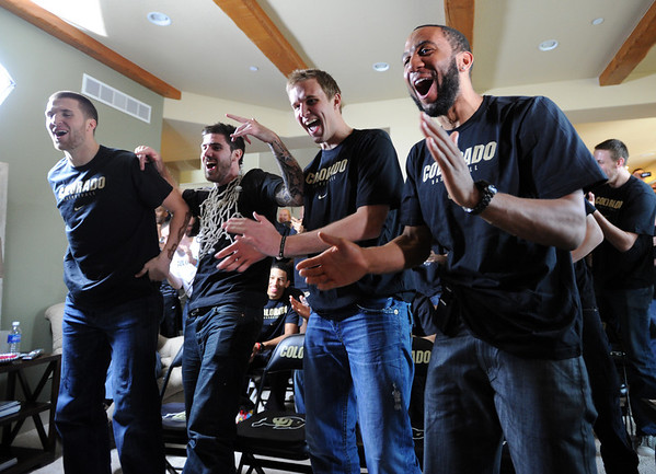 """Austin Dufault, left, Nate Tomlinson, Trey Eckloff, and Carlon Brown, react to their match up with UNLV.<br /> The University of Colorado Men's basketball team will play UNLV in the first game of the NCAA tournament on Thursday.<br /> For  a video of the Buffs, go to  <a href=""""http://www.dailycamera.com"""">http://www.dailycamera.com</a>.<br /> Cliff Grassmick / March 11, 2012"""