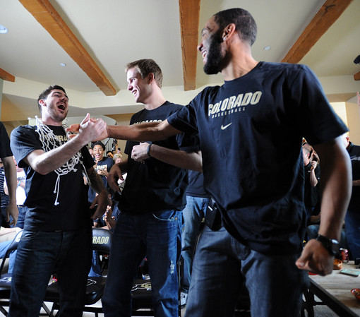 "Nate Tomlinson, left, Trey Eckloff, and Carlon Brown, react to their match up with UNLV.<br /> The University of Colorado Men's basketball team will play UNLV in the first game of the NCAA tournament on Thursday.<br /> For  a video of the Buffs, go to  <a href=""http://www.dailycamera.com"">http://www.dailycamera.com</a>.<br /> Cliff Grassmick / March 11, 2012"