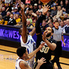 "University of Colorado's Carlon Brown takes a shot over Antonio Wertz, middle, and Lenny Harmon during a game against the University of New Orleans on Wednesday, Dec. 28, at the Coors Event Center on the CU campus in Boulder. CU won 92-34. For more photos of the game go to  <a href=""http://www.dailycamera.com"">http://www.dailycamera.com</a><br />  Jeremy Papasso/ Camera"