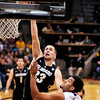 "University of Colorado's Austin Dufault goes for a shot over Lenny Harmon during a game against the University of New Orleans on Wednesday, Dec. 28, at the Coors Event Center on the CU campus in Boulder. For more photos of the game go to  <a href=""http://www.dailycamera.com"">http://www.dailycamera.com</a><br />  Jeremy Papasso/ Camera"