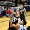 """Austin Dufault of Colorado goes up over Lenny Harmon of New Orleans.<br /> For more photos of the game, go to  <a href=""""http://www.dailycamera.com"""">http://www.dailycamera.com</a>.<br /> December 28, 2011 / Cliff Grassmick"""