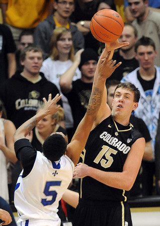 """Shane Harris-Tunks of CU, blocks the shot of Antonio Holmes of New Orleans.<br /> For more photos of the game, go to  <a href=""""http://www.dailycamera.com"""">http://www.dailycamera.com</a>.<br /> December 28, 2011 / Cliff Grassmick"""