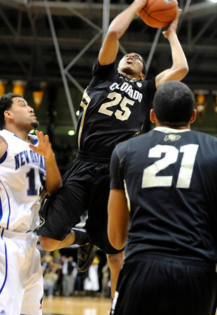 """University of Colorado's Spencer Dinwiddie takes a shot over Lenny Harmon, left, during a game against the University of New Orleans on Wednesday, Dec. 28, at the Coors Event Center on the CU campus in Boulder. CU won 92-34. For more photos of the game go to  <a href=""""http://www.dailycamera.com"""">http://www.dailycamera.com</a><br />  Jeremy Papasso/ Camera"""