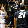 "University of Colorado's Spencer Dinwiddie takes a shot over Lenny Harmon, left, during a game against the University of New Orleans on Wednesday, Dec. 28, at the Coors Event Center on the CU campus in Boulder. CU won 92-34. For more photos of the game go to  <a href=""http://www.dailycamera.com"">http://www.dailycamera.com</a><br />  Jeremy Papasso/ Camera"
