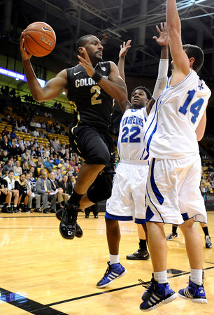 """University of Colorado's Shannon Sharpe looks for a pass during a game against the University of New Orleans on Wednesday, Dec. 28, at the Coors Event Center on the CU campus in Boulder. For more photos of the game go to  <a href=""""http://www.dailycamera.com"""">http://www.dailycamera.com</a><br />  Jeremy Papasso/ Camera"""