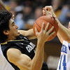 "Sabatino Chen of CU gets a rebound from Chris Costanza of New Orleans.<br /> For more photos of the game, go to  <a href=""http://www.dailycamera.com"">http://www.dailycamera.com</a>.<br /> December 28, 2011 / Cliff Grassmick"