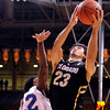 "University of Colorado's Sabatino Chen goes for a shot over Colby Barnes, No. 22, during a game against the University of New Orleans on Wednesday, Dec. 28, at the Coors Event Center on the CU campus in Boulder. For more photos of the game go to  <a href=""http://www.dailycamera.com"">http://www.dailycamera.com</a><br />  Jeremy Papasso/ Camera"