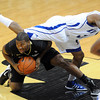 """Rarlensee Nelson jumps over Jeremy Adams of Colorado.<br /> For more photos of the game, go to  <a href=""""http://www.dailycamera.com"""">http://www.dailycamera.com</a>.<br /> December 28, 2011 / Cliff Grassmick"""