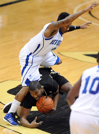 "Rarlensee Nelson jumps over Jeremy Adams of Colorado.<br /> For more photos of the game, go to  <a href=""http://www.dailycamera.com"">http://www.dailycamera.com</a>.<br /> December 28, 2011 / Cliff Grassmick"