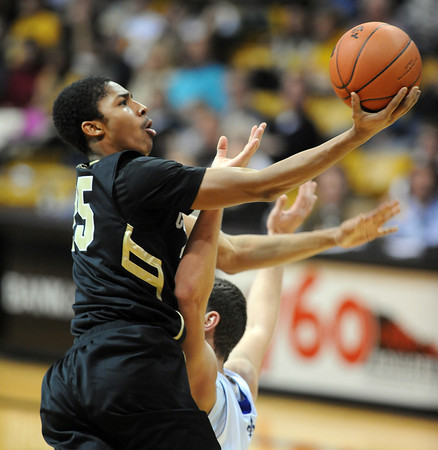 """Spencer Dinwiddie of CU scores on New Orleans on Wednesday.<br /> For more photos of the game, go to  <a href=""""http://www.dailycamera.com"""">http://www.dailycamera.com</a>.<br /> December 28, 2011 / Cliff Grassmick"""