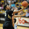 "Spencer Dinwiddie of CU scores on New Orleans on Wednesday.<br /> For more photos of the game, go to  <a href=""http://www.dailycamera.com"">http://www.dailycamera.com</a>.<br /> December 28, 2011 / Cliff Grassmick"