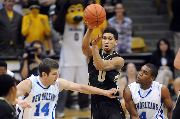 "Askia Booker of CU gets the fastbreak started against New Orleans.<br /> For more photos of the game, go to  <a href=""http://www.dailycamera.com"">http://www.dailycamera.com</a>.<br /> December 28, 2011 / Cliff Grassmick"