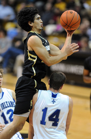 """Sabatino Chen of CU drives into Chris Costanza of New Orleans.<br /> For more photos of the game, go to  <a href=""""http://www.dailycamera.com"""">http://www.dailycamera.com</a>.<br /> December 28, 2011 / Cliff Grassmick"""