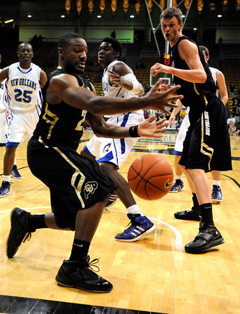 """University of Colorado's Shannon Sharpe tries to save a loose ball during a game against the University of New Orleans on Wednesday, Dec. 28, at the Coors Event Center on the CU campus in Boulder. CU won 92-34. For more photos of the game go to  <a href=""""http://www.dailycamera.com"""">http://www.dailycamera.com</a><br />  Jeremy Papasso/ Camera"""
