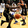 "University of Colorado's Shannon Sharpe tries to save a loose ball during a game against the University of New Orleans on Wednesday, Dec. 28, at the Coors Event Center on the CU campus in Boulder. CU won 92-34. For more photos of the game go to  <a href=""http://www.dailycamera.com"">http://www.dailycamera.com</a><br />  Jeremy Papasso/ Camera"